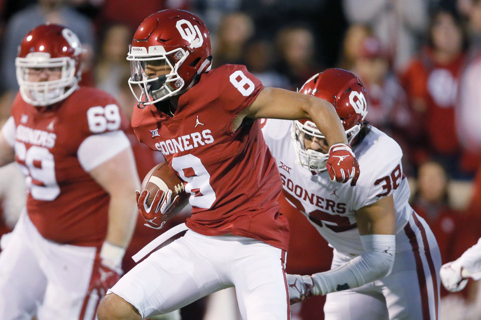 Photo - Oklahoma's Trejan Bridges (8) runs past Oklahoma's Bryan Mead (38) after catching a pass during the University of Oklahoma's (OU) spring football game at Gaylord Family-Oklahoma Memorial Stadium in Norman, Okla., Friday, April 12, 2019. Photo by Bryan Terry, The Oklahoman