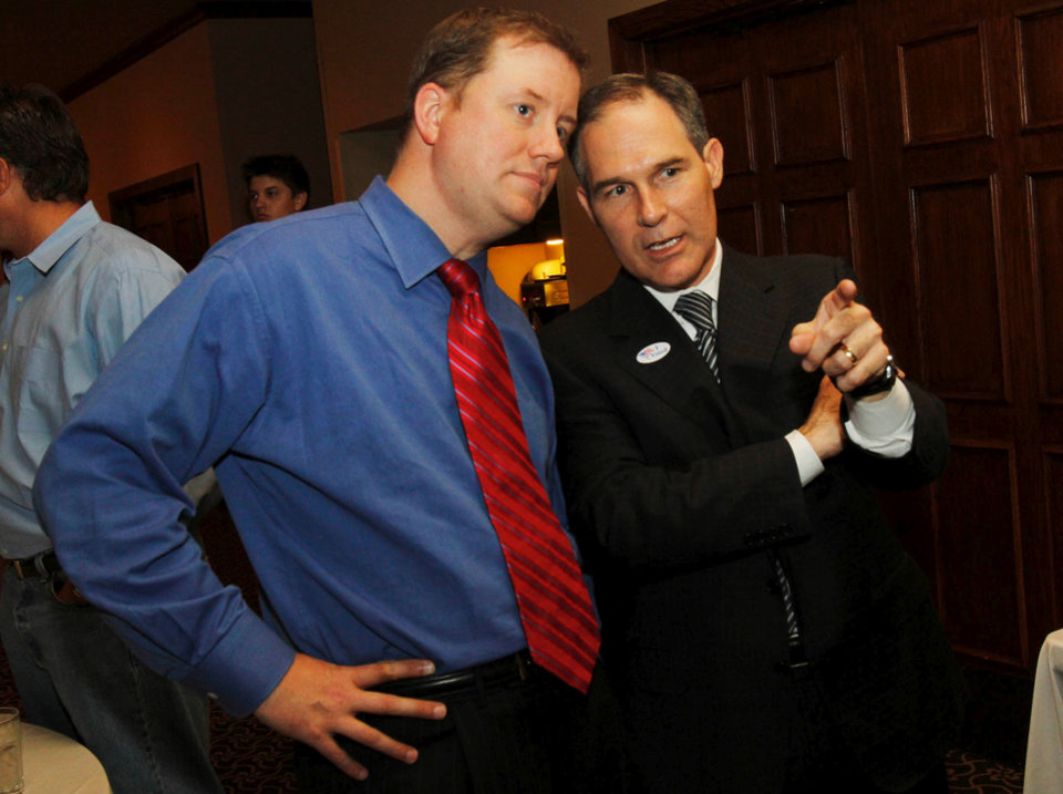 Photo - Senator Dan Newberry (left) chats with Candidate for Attorney General Scott Pruitt during his watch party at the Cedar Ridge Country Club in Tulsa, Okla., on July 27,2010. JAMES GIBBARD/Tulsa World