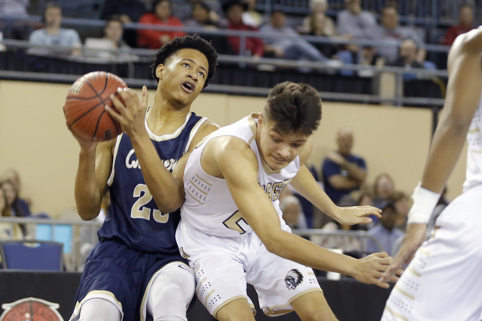 Photo - Heritage Hall's Trey Alexander tries to get past Broke Bow's Kyle Park during a Class 4A state tournament basketball game between Heritage Hall and Broken Bow High School in Jim Norick Arena at State Fair Park in Oklahoma City, Thursday, March 7, 2019. Photo by Bryan Terry, The Oklahoman