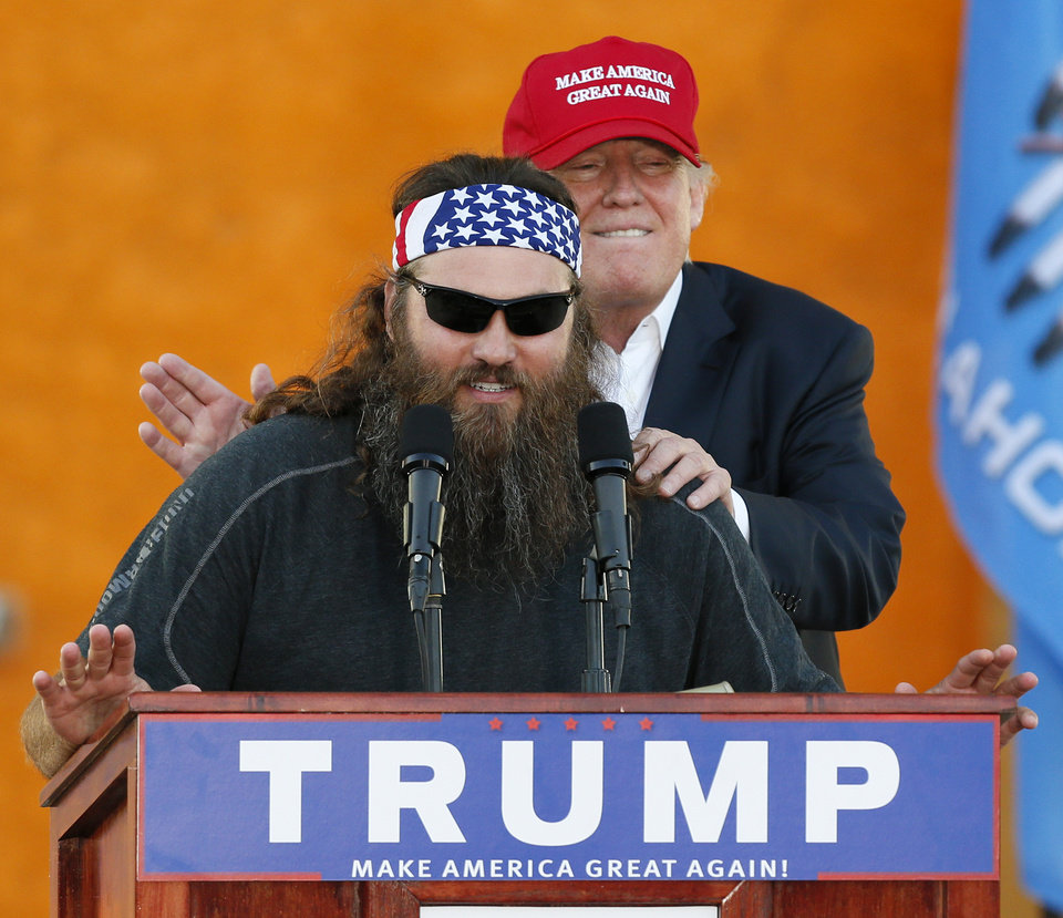 "Photo - Willie Robertson from the television show ""Duck Dynasty"" gets a pat on the back as he speaks in support of Republican presidential candidate Donald Trump during the Oklahoma State Fair at State Fair Park in Oklahoma City, Friday, Sept. 25, 2015. Photo by Nate Billings, The Oklahoman"