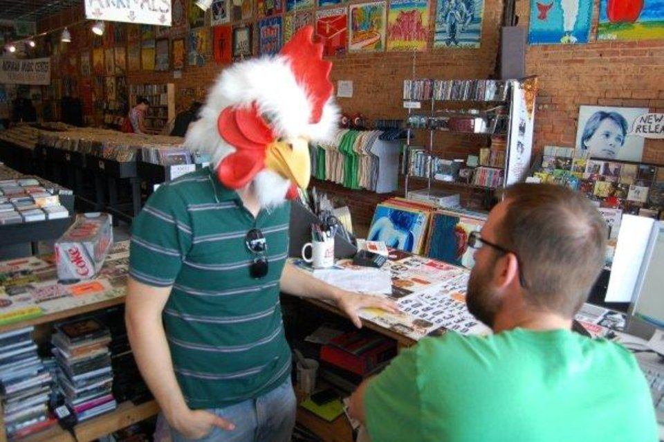 Photo -  Guestroom Records owners Justin Sowers (left, in chicken head) and Travis Searle. [photo provided]