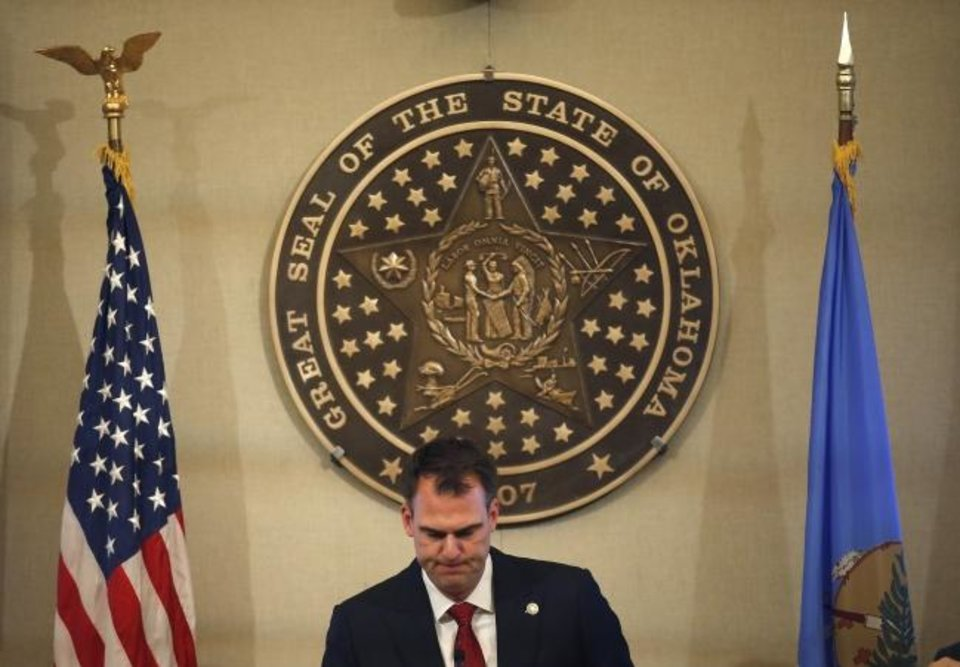 Photo -  Gov. Kevin Stitt announces his plans allow some Oklahoma businesses to reopen during a press conference at the state Capitol in Oklahoma City, Wednesday, April 22, 2020. [Sarah Phipps/The Oklahoman]