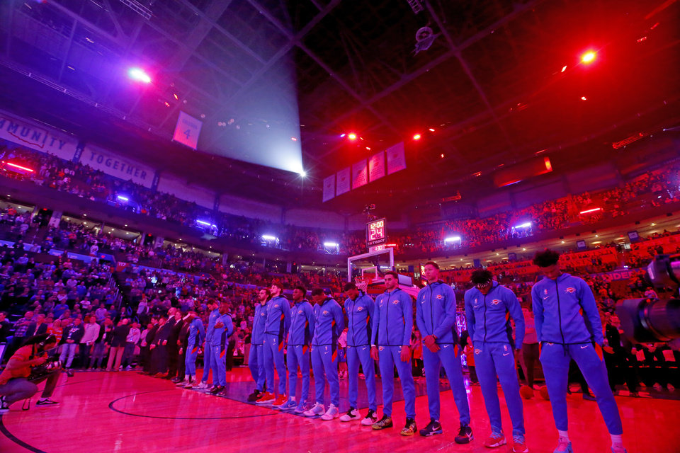 Photo - The Thunder stand for the national anthem before the NBA basketball game between the Oklahoma City Thunder and the Sacramento Kings at the Chesapeake Energy arena in Oklahoma City,  Thursday, Feb. 27, 2020.  [Sarah Phipps/The Oklahoman]