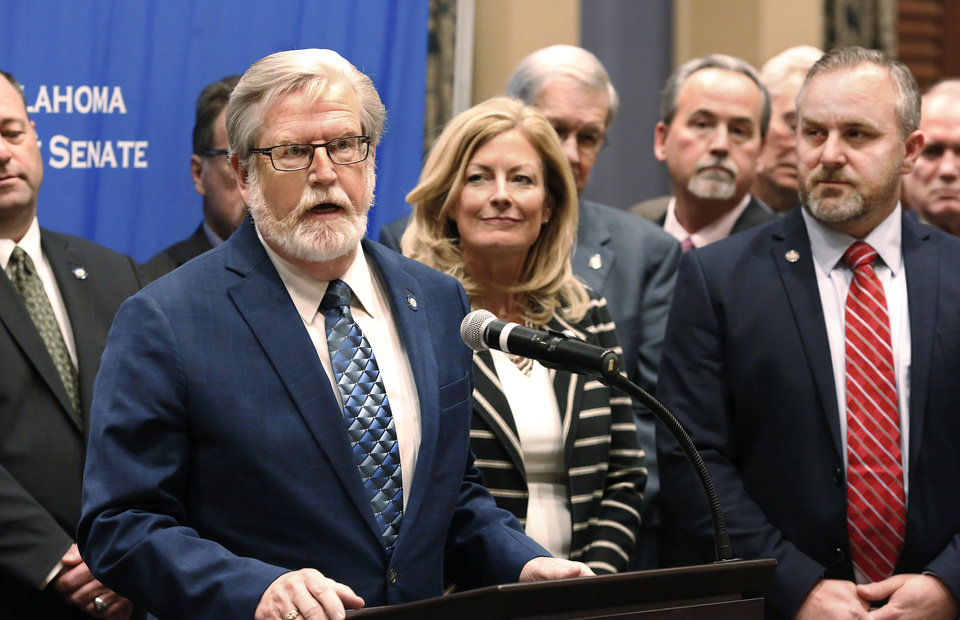 Photo -  Sen. Roger Thompson speaks at a news conference Tuesday at the state Capitol. [Photo by Jim Beckel, The Oklahoman.]