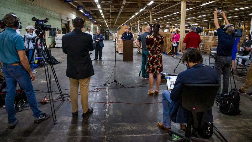 Photo - Gov. Kevin Stitt speaks during a press conference in Oklahoma City, Okla. on Tuesday, April 7, 2020 where the State of Oklahoma has amassed it stockpile of personal protection equipment and medical supplies for the State's COVID-19 response.   [Chris Landsberger/The Oklahoman]