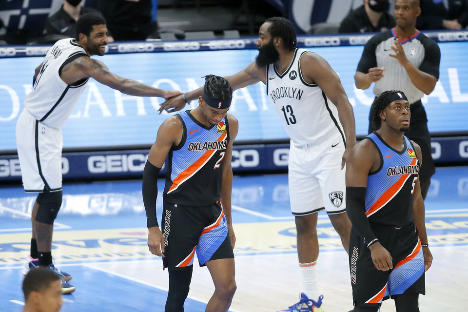 Photo - Brooklyn's Kyrie Irving (11) and James Harden (13) celebrate behind Oklahoma City's Shai Gilgeous-Alexander (2) and Luguentz Dort (5) during an NBA basketball game between the Oklahoma City Thunder and the Brooklyn Nets at Chesapeake Energy Arena in Oklahoma City, Friday, Jan. 29, 2021. [Bryan Terry/The Oklahoman]