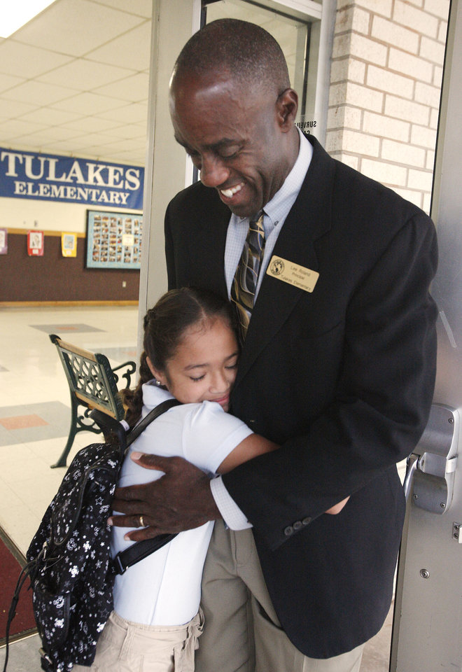 Photo -  Lee Roland greets students on the first day of school at Tulakes Elementary in 2012. [PHOTO BY PAUL B. SOUTHERLAND, THE OKLAHOMAN ARCHIVES]