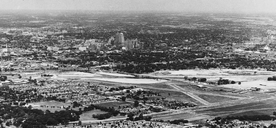 Photo - The Downtown Airpark is shown along a shallow Oklahoma River (then known as the North Canadian River) with downtown in the foreground in this Dec. 28, 1961 photo. [THE OKLAHOMAN ARCHIVES}