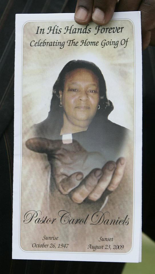 Photo - MURDER / HOMICIDE / PASTOR: The program for the funeral of Rev. Carol Daniels is pictured in Oklahoma City, Monday, Aug. 31, 2009. Davis, a pastor, was slain inside her small church in Anadarko, Okla. as she prepared for a Sunday service on Aug. 23.  (AP Photo/Sue Ogrocki) ORG XMIT: OKSO102