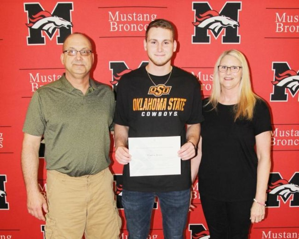 Photo -  Bronco 4 Ever Scholarship recipient Curtis Josey, center, is pictured with his parents, Jon Josey and Jane Wallis. [PHOTO PROVIDED]