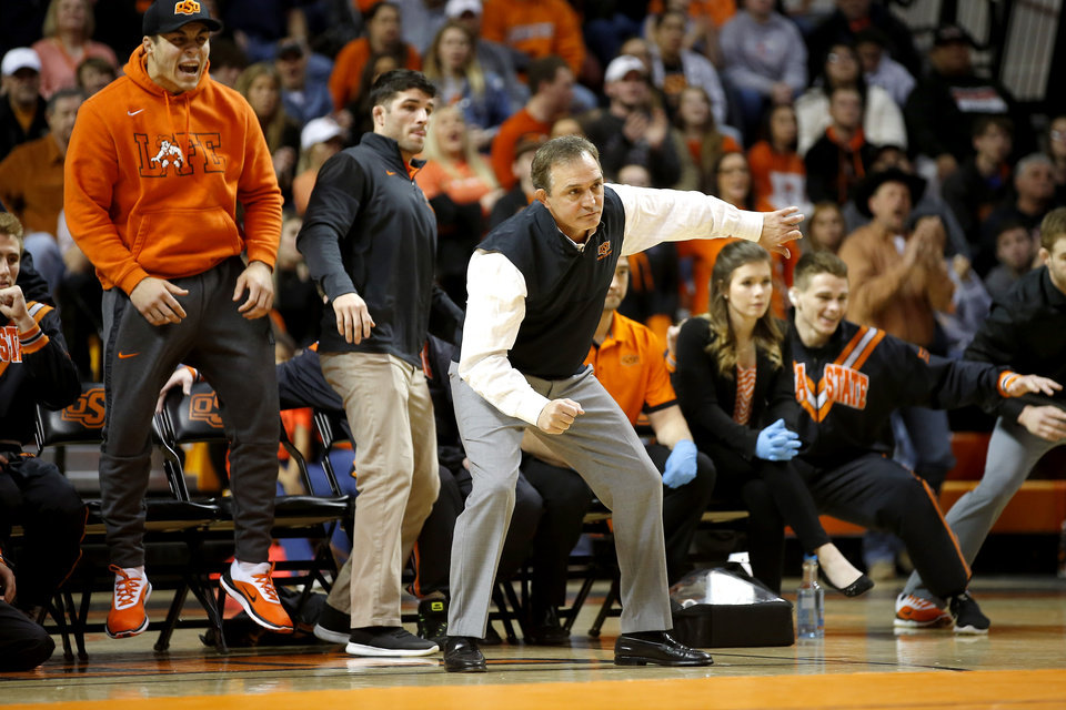 Photo - Oklahoma State coach John Smith gestures during a Bedlam college wrestling dual between the Oklahoma State Cowboys (OSU) and the University of Oklahoma Sooners (OU) at Gallagher-Iba Arena in Stillwater, Okla., Sunday, Feb. 11, 2018.  Photo by Bryan Terry, The Oklahoman