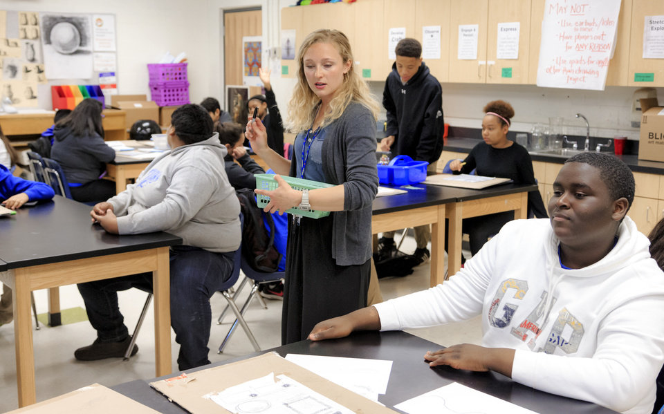 Photo - Teacher Katie Guthrie works with her students in art class at Roosevelt Middle School in Oklahoma City, Okla. on Monday, April 16, 2018. Oklahoma City Public School students and teachers returned to class after the two week statewide teacher walkout.  Photo by Chris Landsberger, The Oklahoman