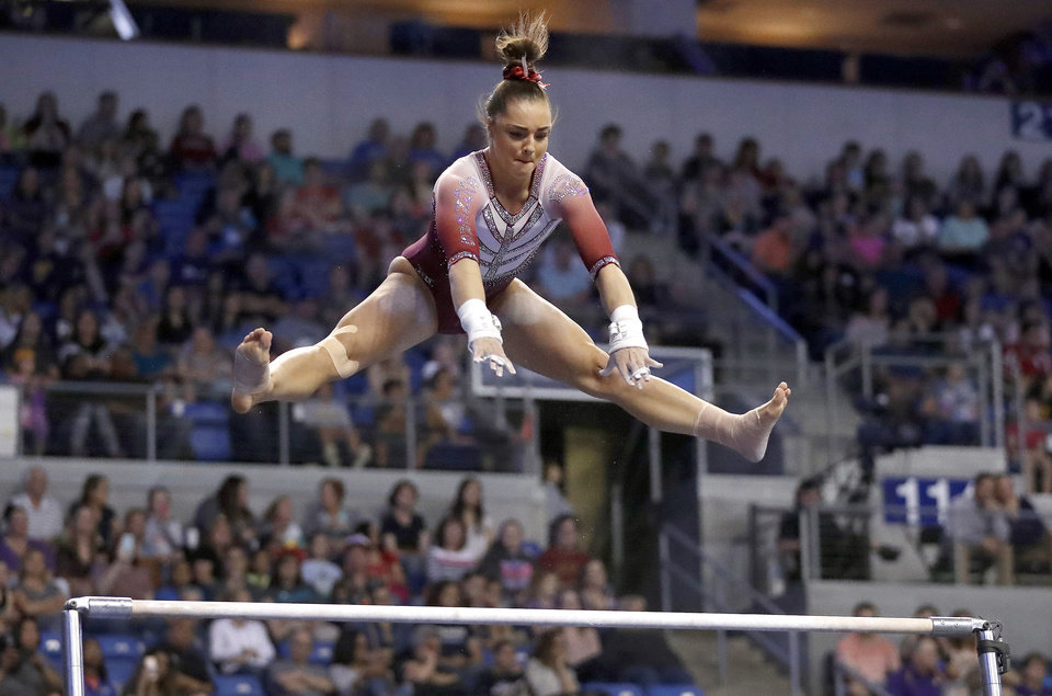 Photo - FILE- In this April 15, 2017, file photo, Oklahoma's Maggie Nichols competes on the uneven parallel bars during the NCAA college women's gymnastics championships in St. Louis. Nichols, a former Olympic hopeful, says she is among more than 100 women and girls who say they are victims of sexual abuse by a now-imprisoned Michigan sports doctor. She said in a statement Tuesday, Jan. 9, 2018, that Dr. Larry Nassar violated her innocence at the Karolyi Ranch Olympic training camp in Texas.  (AP Photo/Jeff Roberson, File)