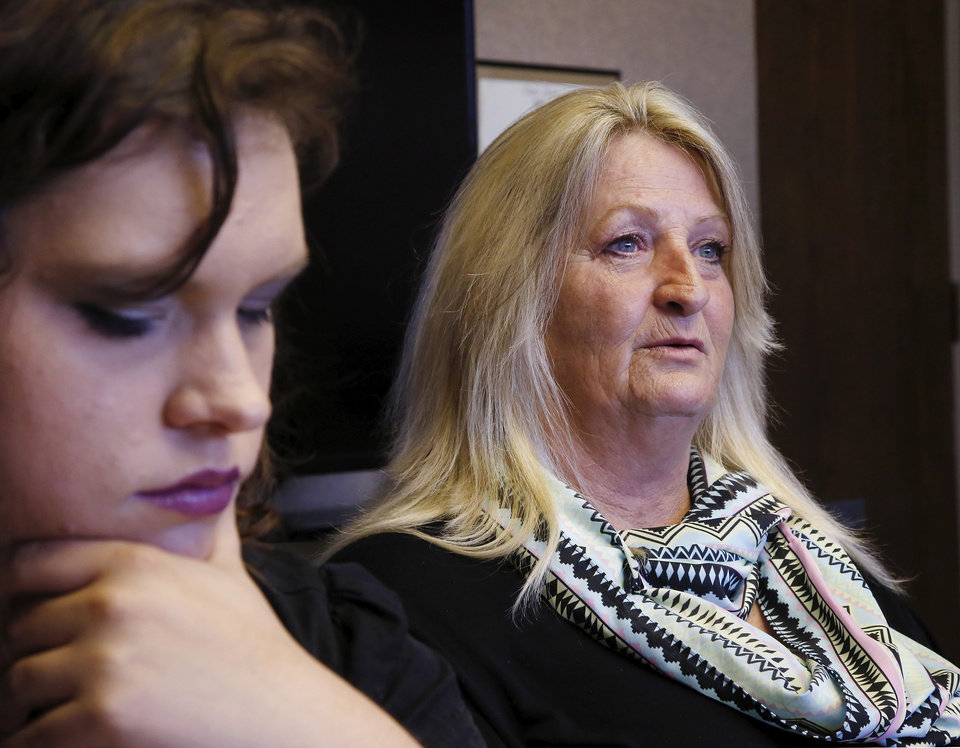 Photo -  Michael Tate Reed II's mother, Crystal Tucker, right seated beside Dena Lynch, who called herself one of Reed's best friends, during an interview in the office of the Mental Health Association Oklahoma in Tulsa on Wednesday, Oct. 29, 2014. Reed has suffered from serious mental illness for at least two years, his family says. Reed hasnÕt ever been formally diagnosed, but mental health experts have told the family that Reed likely has schizoaffective disorder, a brain disease that is a mix of schizophrenia and bipolar disorder. Reed is at a mental health facility, and his family and friends hope he doesnÕt have to spend time in prison when they say heÕs suffering from a mental illness and is not a terrorist or Satanist, as some have called him after he admitted to law officers that he drove his vehicle onto the lawn of the state Capitol and crashed into the Ten Commandments monument, toppling it from its base and breaking it into several pieces. Photo by Jim Beckel, The Oklahoman   Jim Beckel -  THE OKLAHOMAN