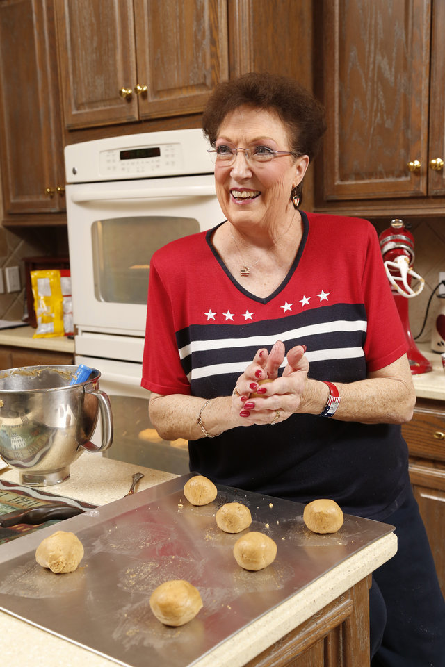 Photo -  Betty Hulson bakes cookies in the kitchen of her Edmond home on a recent Tuesday afternoon. Hulson bakes cookies every week to bring to the YMCA Military Welcome Center at Will Rogers World Airport. [Photo by Jim Beckel, The Oklahoman]