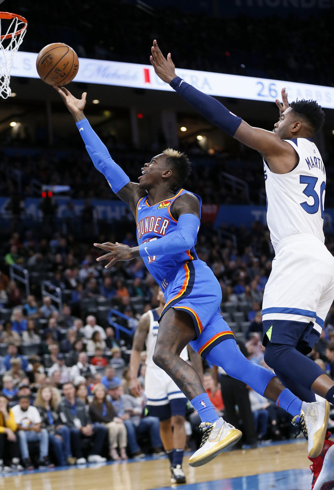 Photo - Oklahoma City's Dennis Schroder (17) shoots in front of Minnesota's Kelan Martin (30) in the first quarter during an NBA basketball game between the Minnesota Timberwolves and the Oklahoma City Thunder at Chesapeake Energy Arena in Oklahoma City, Friday, Dec. 6, 2019. [Nate Billings/The Oklahoman]