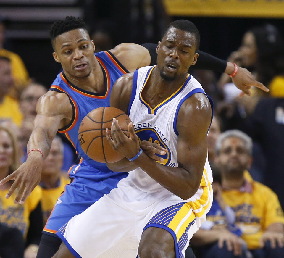 Photo - Oklahoma City's Russell Westbrook (0) defends Golden State's Harrison Barnes (40) during Game 5 of the Western Conference finals in the NBA playoffs between the Oklahoma City Thunder and the Golden State Warriors at Oracle Arena in Oakland, Calif., Thursday, May 26, 2016. Photo by Nate Billings, The Oklahoman