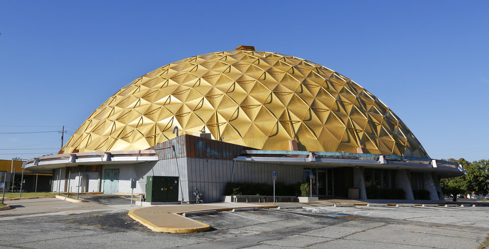 Photo -  The Gold Dome building at NW 23 Street and Classen Boulevard has been painted a slightly dull shade of gold since work began on the vacant structure.  Photo by Paul B. Southerland, The Oklahoman   PAUL B. SOUTHERLAND -  PAUL B. SOUTHERLAND