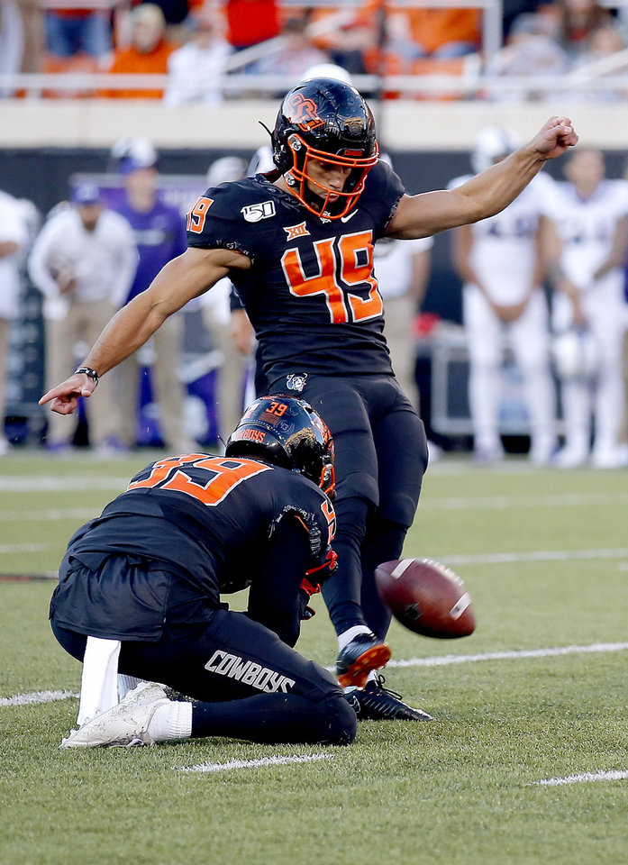 Photo - Oklahoma State's Matt Ammendola (49) kicks a 43-yard field goal as Jake McClure (39) holds in the fourth quarter during the college football game between the Oklahoma State University Cowboys and the TCU Horned Frogs at Boone Pickens Stadium in Stillwater, Okla.,  Saturday, Nov. 2, 2019. [Sarah Phipps/The Oklahoman]
