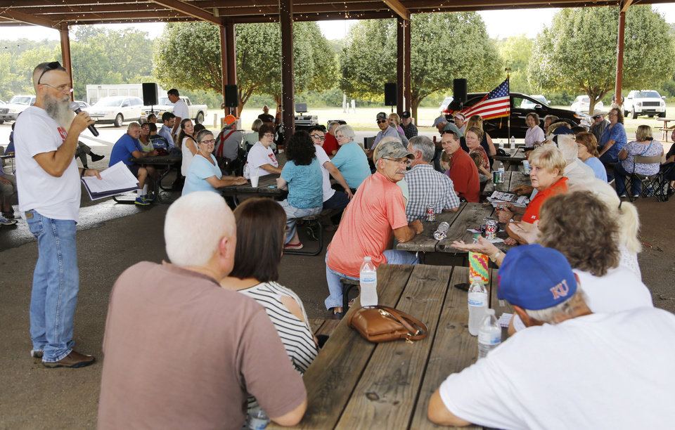 Photo -  Paul Crouch speaks Friday at Choctaw Creek Park in Choctaw during a rally against a proposed eastern Oklahoma County turnpike. [Photos by Doug Hoke, The Oklahoman]