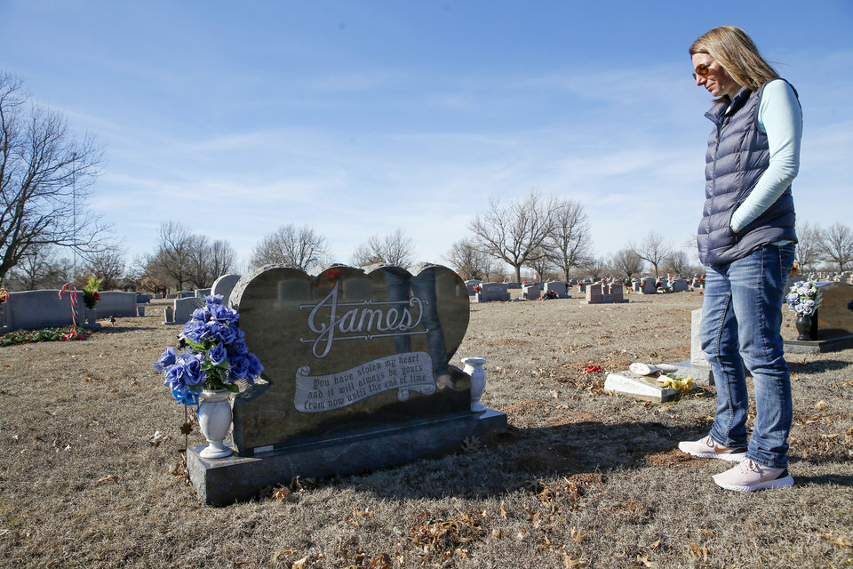 Photo - Jennell James looks at the gravesite for her father, Darrell