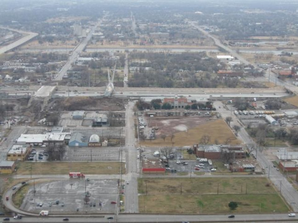 Photo -  The future site of Scissortail Park is shown in this 2007 photo taken after demolition of the six-story postal facility that stood in the middle of the future park. Oklahoman Archives.