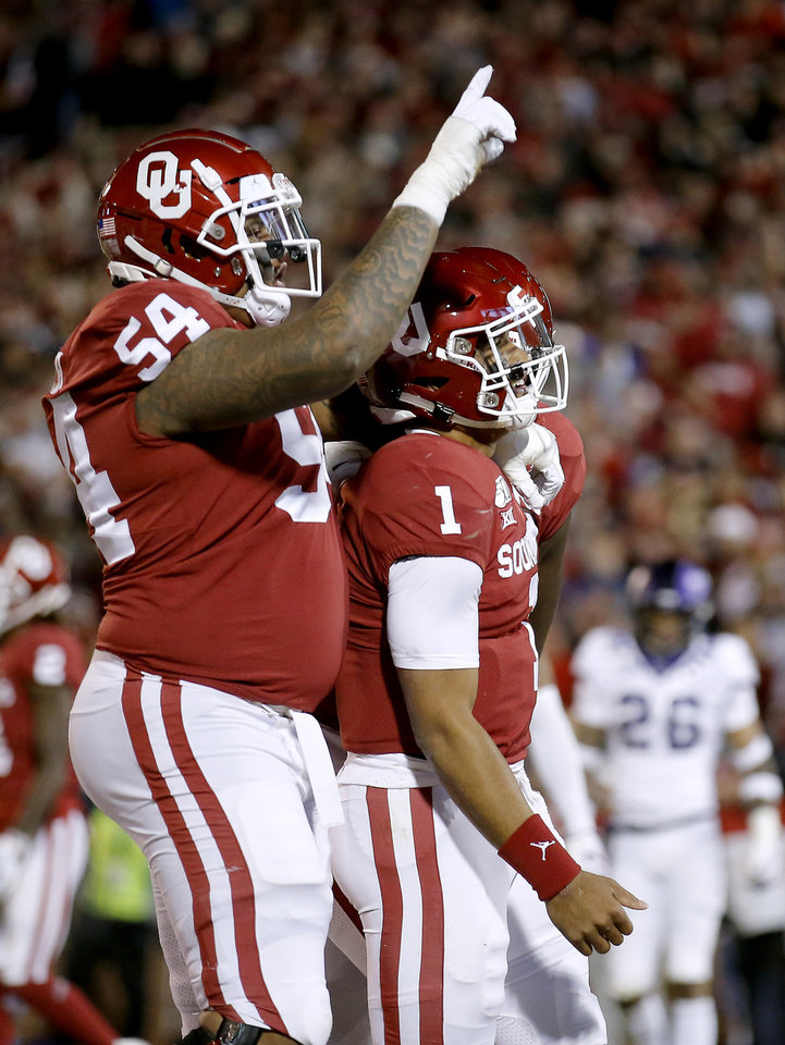Photo - Oklahoma's Jalen Hurts (1) celebrates a touchdown with Marquis Hayes (54) in the first quarter during an NCAA football game between the University of Oklahoma Sooners (OU) and the TCU Horned Frogs at Gaylord Family-Oklahoma Memorial Stadium in Norman, Okla., Saturday, Nov. 23, 2019. [Sarah Phipps/The Oklahoman]