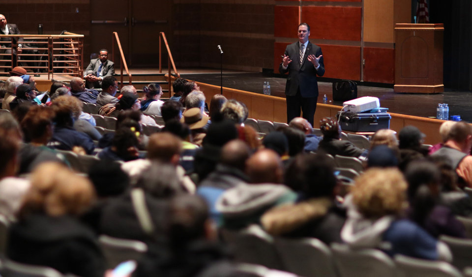 Photo - School Superintendent Sean McDaniel goes over the plans at a community meeting Douglass Mid-High School in this photo from Jan. 29. [Photo by Doug Hoke, The Oklahoman]