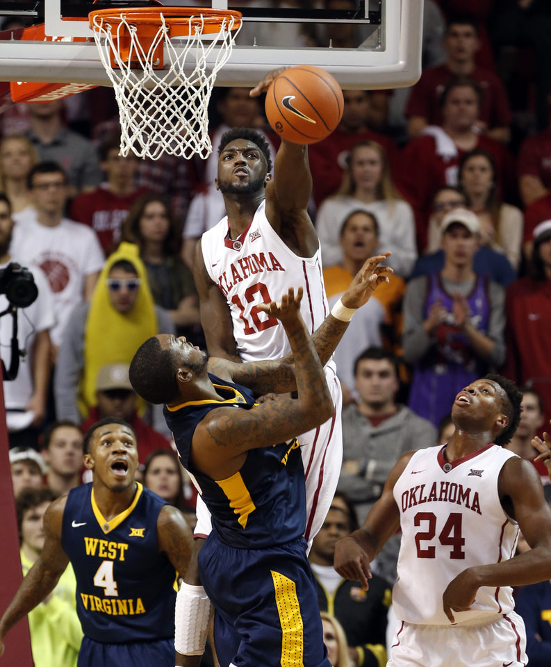Photo - Oklahoma's Khadeem Lattin (12) blocks a shot by West Virginia's Elijah Macon (45) as the University of Oklahoma Sooner (OU) men defeat the West Virginia Mountaineers (WV) 70-68 in NCAA, college basketball at The Lloyd Noble Center on Jan. 16, 2016 in Norman, Okla. Photo by Steve Sisney, The Oklahoman