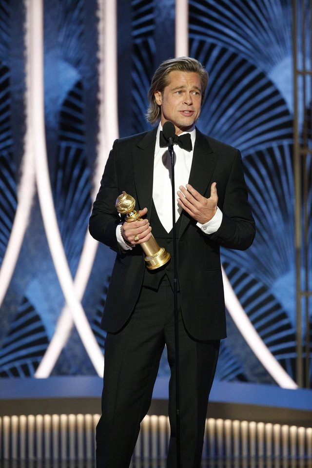Photo - Brad Pitt accepts the award for best supporting actor in a film for his role in &