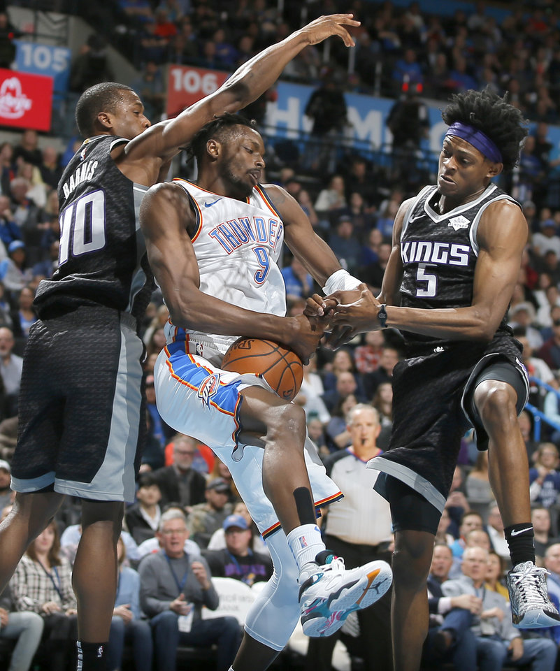 Photo - Oklahoma City's Jerami Grant (9) fights for the ball between Sacramento's Harrison Barnes (40) and De'Aaron Fox (5) during an NBA basketball game between the Oklahoma City Thunder and the Sacramento Kings at Chesapeake Energy Arena in Oklahoma City, Saturday, Feb. 23, 2019. Photo by Bryan Terry, The Oklahoman