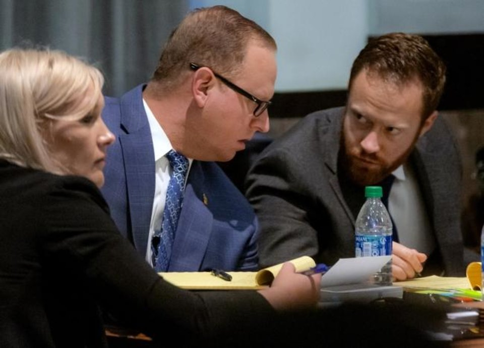 Photo -  Oklahoma City police Sgt. Keith Patrick Sweeney, center, who is charged with second-degree murder in the 2017 death of an unarmed suicidal man, sits in his trial in the courtroom of District Judge Natalie Mai at the Oklahoma County Courthouse on Thursday. Evan King, at right, and Patty Landerth, at left, are members of Sweeney's legal team. [Chris Landsberger/The Oklahoman]