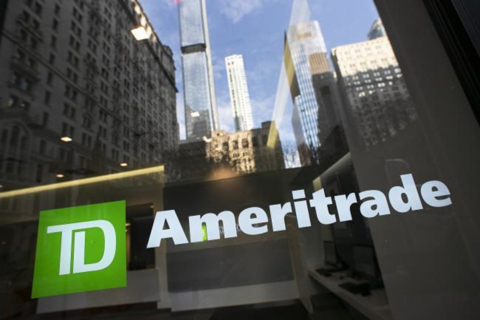 Photo -  A sign for TD Ameritrade is shown on an office window for the brokerage. [AP PHOTO]