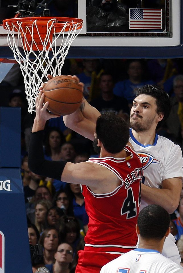 Photo - Oklahoma City's Steven Adams (12) fouls Chicago's Nikola Mirotic (44) during the NBA game between the Oklahoma City Thunder and the Chicago Bulls at Chesapeake Energy Arena in Oklahoma City, Sunday, March  15, 2015. Photo by Sarah Phipps, The Oklahoman