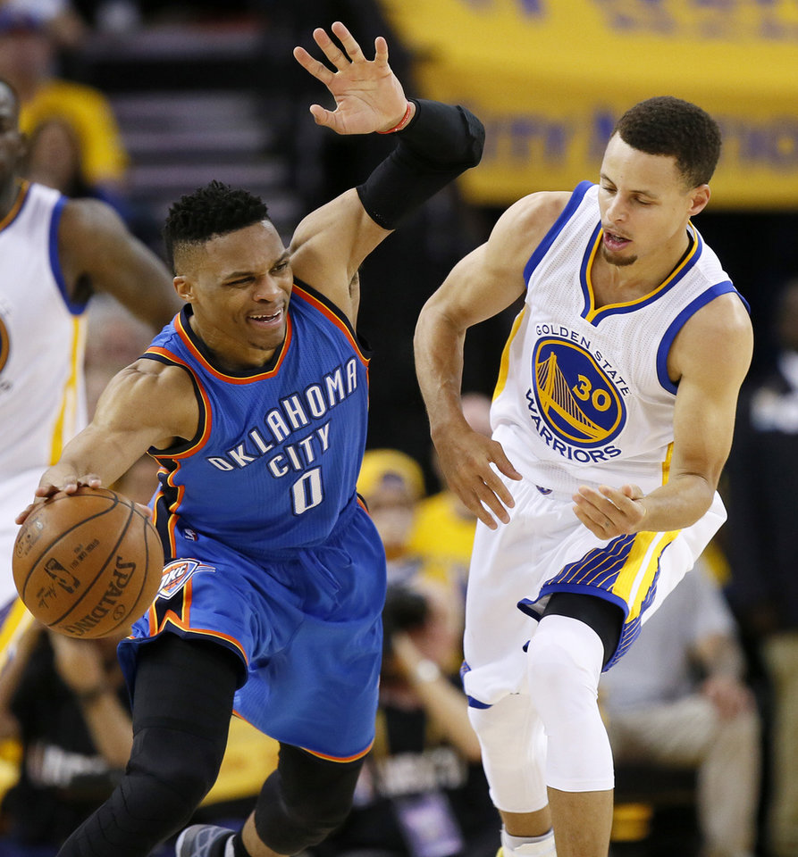 Photo - Oklahoma City's Russell Westbrook (0) reacts as he is defended by Golden State's Stephen Curry (30) in the third quarter during Game 2 of the Western Conference finals in the NBA playoffs between the Oklahoma City Thunder and the Golden State Warriors at Oracle Arena in Oakland, Calif., Wednesday, May 18, 2016. Golden State won 118-91. Photo by Nate Billings, The Oklahoman
