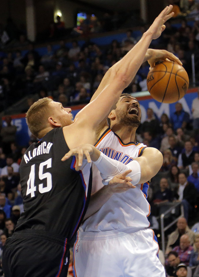 Photo - Oklahoma City's Enes Kanter (11) and Los Angeles Clippers' Cole Aldrich (45) battle for a rebound during the NBA basketball game between the Oklahoma City Thunder and the Los Angeles Clippers at Chesapeake Energy Arena on Wednesday, March 9, 2016, in Oklahoma City, Okla. Photo by Chris Landsberger, The Oklahoman