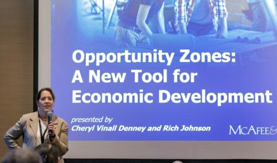 Photo -  Attorney Cheryl Vinall Denney, with McAfee & Taft, talks about Opportunity Zones on Wednesday at the Commercial Real Estate Summit. [CHRIS LANDSBERGER/THE OKLAHOMAN]