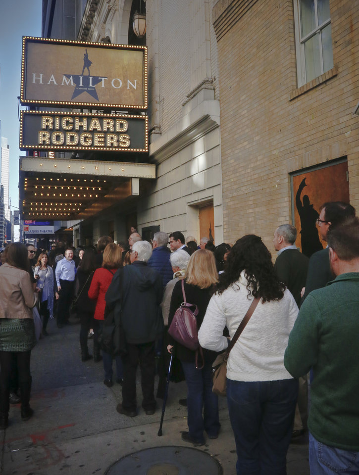 "Photo - People line-up to see the Broadway play ""Hamilton,"" Saturday Nov. 19, 2016, in New York. President-elect Donald Trump demanded an apology from the cast of the hit musical a day after an actor lectured Vice President-elect Mike Pence about equality, prompting angry responses from liberals and conservatives. (AP Photo/Bebeto Matthews)"