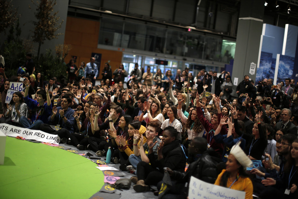 Photo -  People shout slogans during a march organized by the Fridays for Future international movement of school students at the COP25 climate talks congress in Madrid, Spain, Friday, Dec. 13, 2019. The United Nations Secretary-General has warned that failure to tackle global warming could result in economic disaster. (AP Photo/Manu Fernandez)