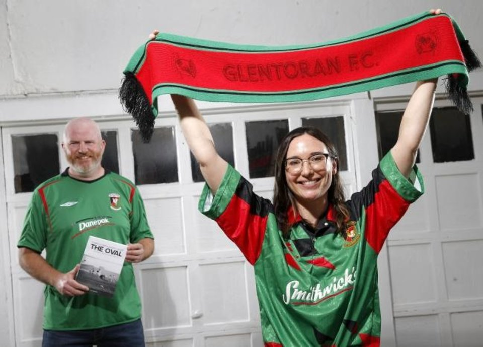 Photo -  Glentoran FC fans Morgan Day, right, and Alan White pose for a photo Thursday in Oklahoma City. Day has a Twitter handle of