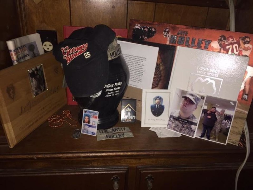 Photo -  An urn containing the ashes of Jeffrey Holley and personal mementos. [Photo provided]