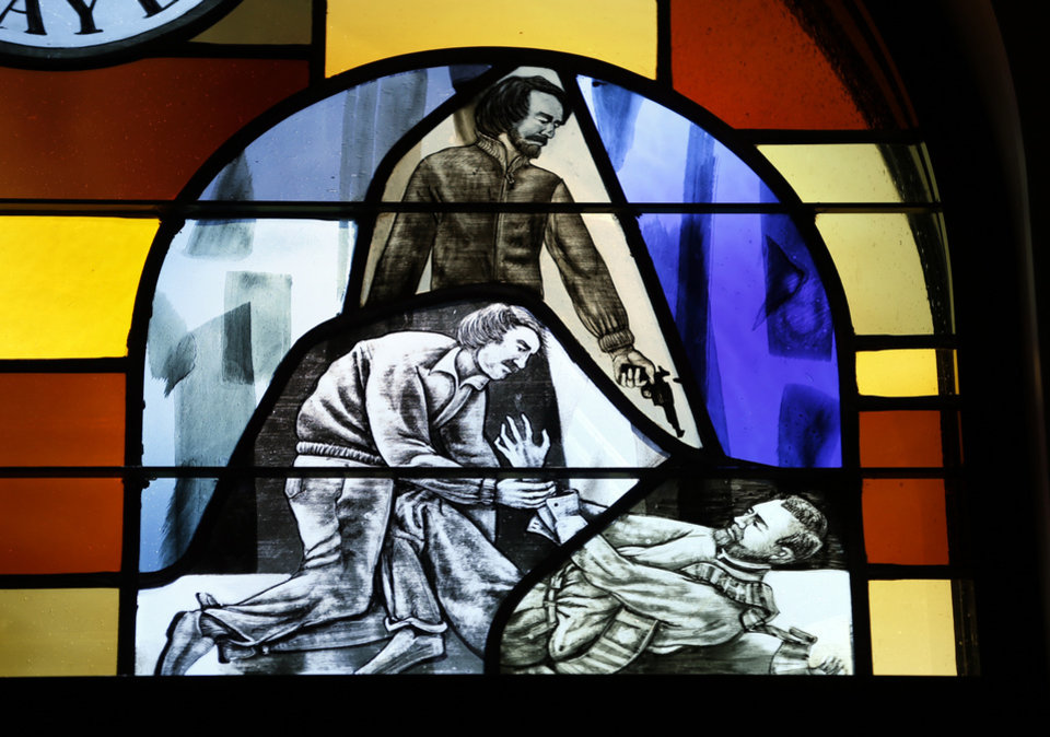 Photo -  A stained glass window at St. Eugene Catholic Church depicts a scene from the life of the late Rev. Stanley Rother. [Photo by Steve Sisney The Oklahoman]