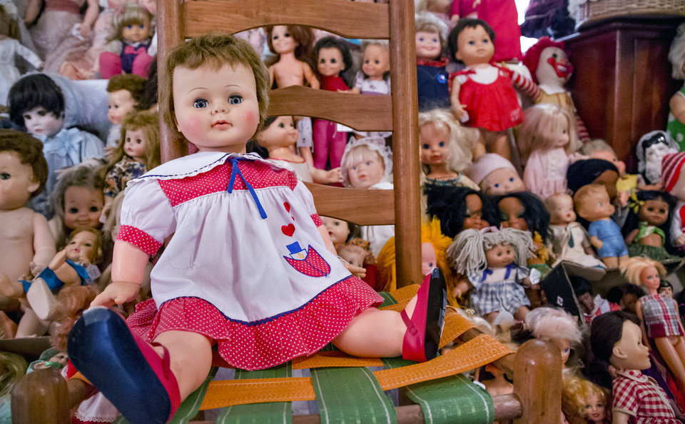 Photo -  Faces of of sizes, shapes and colors make up Imogene McDowell's doll collection. [Photo by Chris Landsberger, The Oklahoman]