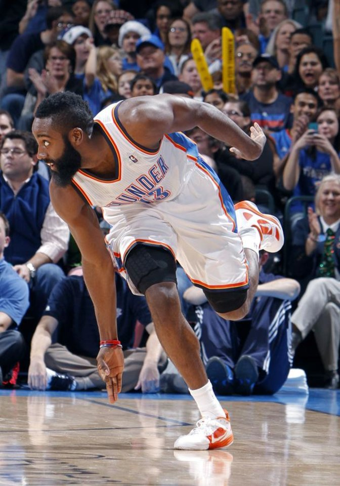 Photo -  Oklahoma City Thunder's James Harden (13) celebrates a 3-point shot during the opening day NBA basketball game between the Oklahoma CIty Thunder and the Orlando Magic at Chesapeake Energy Arena in Oklahoma City, Sunday, Dec. 25, 2011. Photo by Sarah Phipps, The Oklahoman