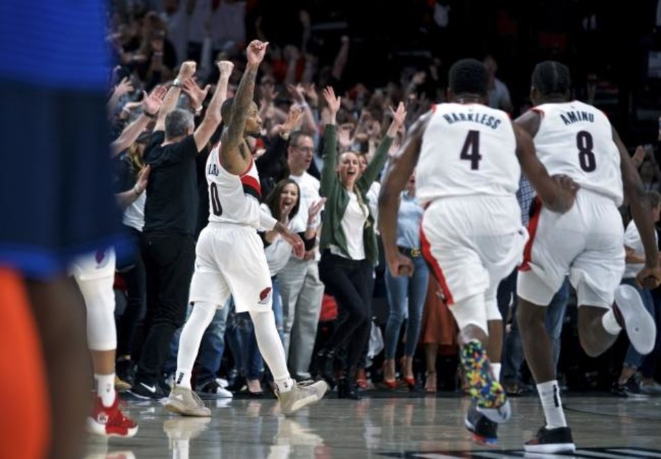 Photo -  Trail Blazers guard Damian Lillard (0) celebrates after making the game-winning shot at the buzzer to end the Thunder's season Tuesday night in Portland. [AP Photo/Craig Mitchelldyer]