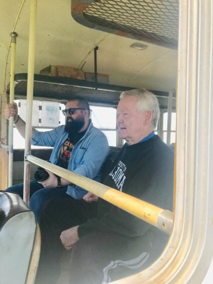 Photo -  Oklahoma City First Church of the Nazarene member Leigh Nichols, at right, enjoys a ride in the newly reburbished Straight Shooters bus, along with Zach Lucero. [Carla Hinton/The Oklahoman]