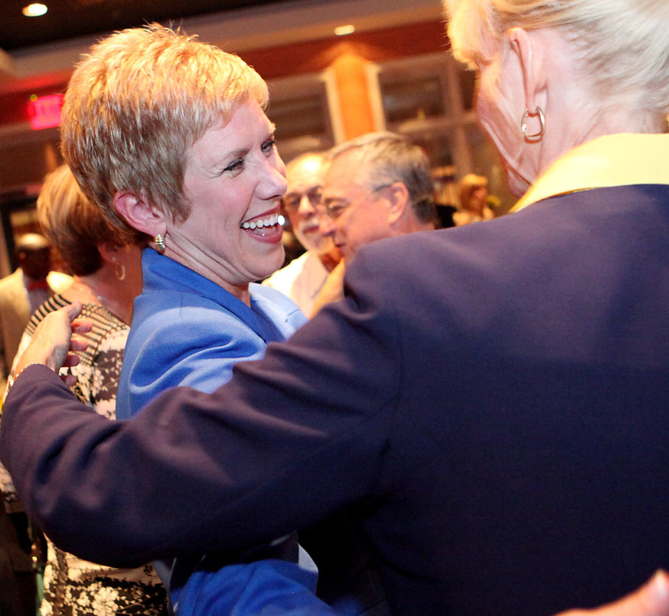 Photo - Janet Barresi greets supporters during a watch party for her Superintendent of Public Education campaign at the Tasting Room in Oklahoma City, Oklahoma on Tuesday, July 27, 2010.  Photo by John Clanton, The Oklahoman