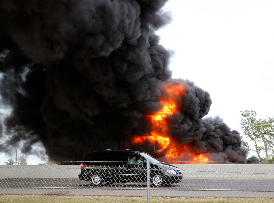 Photo -  A massive fire on a northbound semi trailer loaded with roadway paint shut down Interstate 35 both north and southbound around 6:45 p.m. on Wednesday, July 10, 2013 in Norman, Okla.  Photo by Steve Sisney, The Oklahoman