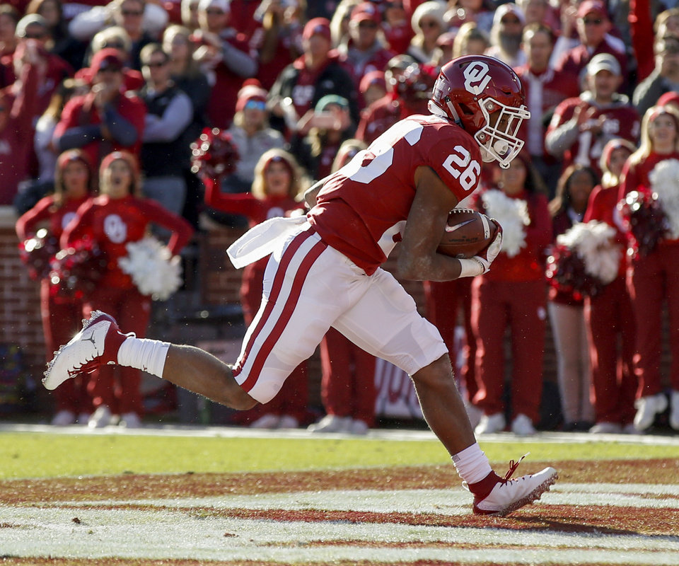 Photo - Oklahoma's Kennedy Brooks (26) scores a touchdown in the first quarter during a Bedlam college football game between the University of Oklahoma Sooners (OU) and the Oklahoma State University Cowboys (OSU) at Gaylord Family-Oklahoma Memorial Stadium in Norman, Okla., Nov. 10, 2018. Photo by Nate Billings, The Oklahoman