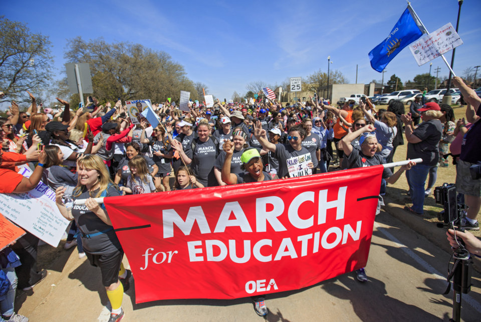 Photo - Teachers cheer as they arrive at the Capitol as they finish their 110 mile walk from Tulsa during the ninth day of a walkout by Oklahoma teachers at the state Capitol in Oklahoma City, Okla. on Tuesday, April 10, 2018.   Photo by Chris Landsberger, The Oklahoman